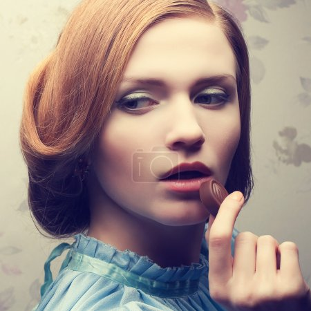 Vintage portrait of a glamorous red-haired (ginger) girl in blue