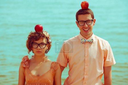 Nerds' honeymoon concept. Portrait of couple of young happy marr