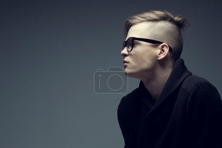 Male beauty concept. Portrait of a fashionable young man with st