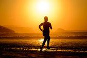 Woman running on beautiful sunset