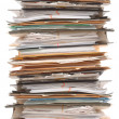 Pile of documents and file folders on white backgr...