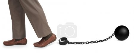 Photo for Man's legs released from ball and chain - Royalty Free Image