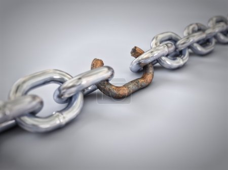Photo for A chain with a broken link highlighted red to highlight the weak link. - Royalty Free Image