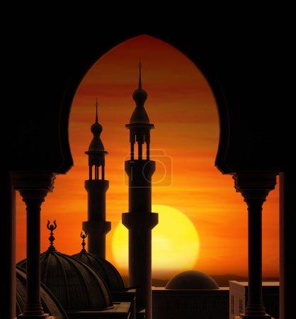 Photo pour Coucher du soleil de boule de feu derrière deux minarets - image libre de droit