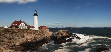 Photo for Daytime shot of Portland Head lighthouse panorama with bluffs and Atlantic Ocean - Royalty Free Image