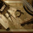 Nautical navigation tools on old world map...