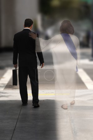 Photo for Double Exposure of a businessman walking down the street with Jesus at his side - Royalty Free Image