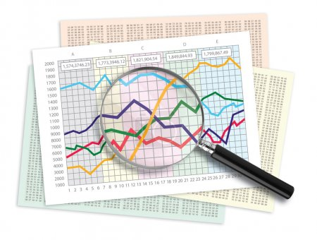 Photo for Magnifying glass over a line graph chart - Royalty Free Image