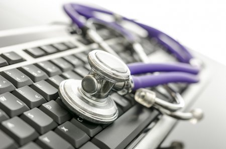Medical stethoscope on computer keyboard