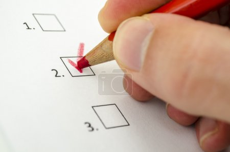 Male hand choosing one of three options