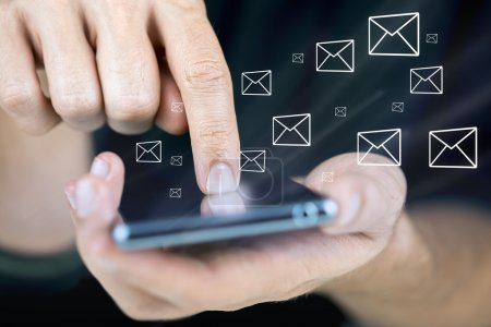 Photo for Closeup of using modern mobile phone with email icons around it. - Royalty Free Image