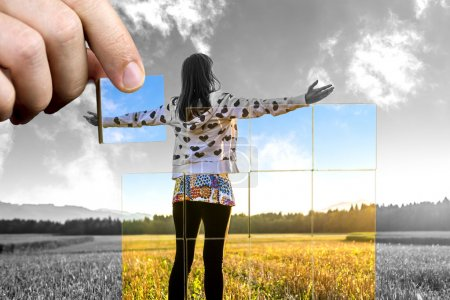 Photo for Young woman standing on field with hands wide open. Concept of positive personal perspective toward life. - Royalty Free Image