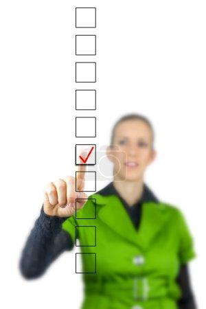 Woman ticking a check box