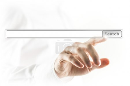 Man touching a search bar on a virtual screen