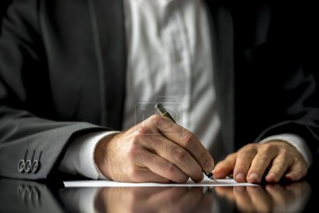Conceptual image of a man signing a last will and ...
