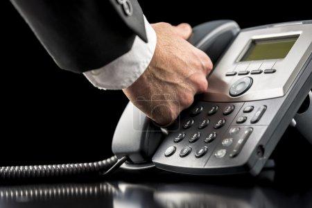 Businessman making a call on a landline