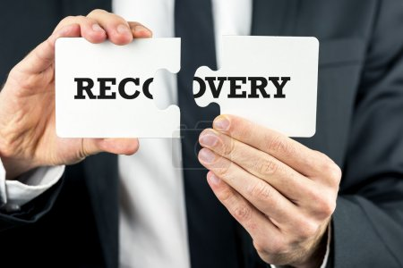 The word Recovery on puzzle pieces