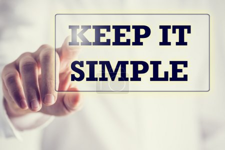 Photo for Keep It Simple in a navigation bar on a virtual screen with a businessman touching it to activate it from behind conceptual of simplicity, clarity and easy understanding in business and in life. - Royalty Free Image