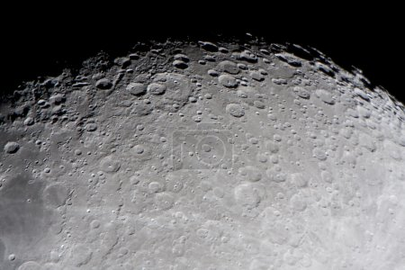 Photo for Picture of the moon surface by telescope. This zone is called terminator, twilight zone or grey - Royalty Free Image