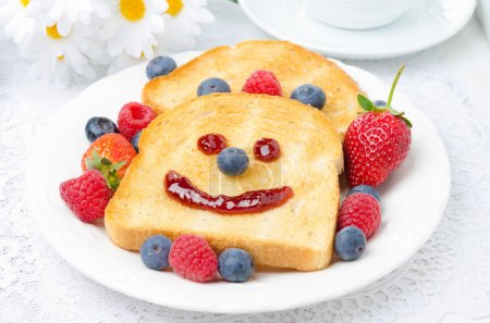 Photo for Breakfast with a smiling toast and fresh berries, closeup - Royalty Free Image