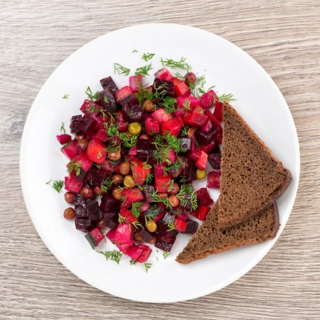 Traditional Russian vegetable salad with beetroot - vinaigrette