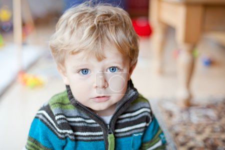 Adorable toddler with blue eyes indoor