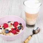 Healthy breakfast with muesli, berries and coffee ...