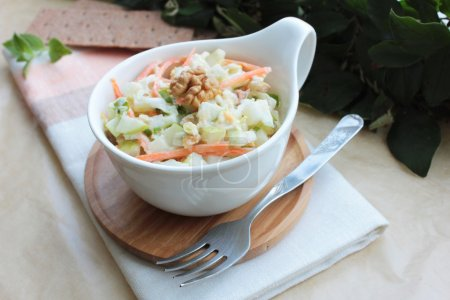 Fresh cabbage salad with carrot, apples and pears