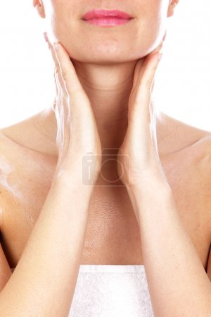 Young Woman Applying Body Cream