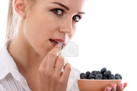 Young Woman Eating Blueberries
