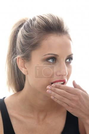 Embarrassed Young Woman Covering Mouth