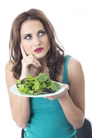 Attractive Young Woman Eating Green Leafed Salad