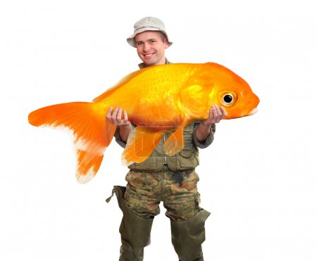 Photo for The fisherman with big fish - The Goldfish (Carassius auratus). Success concept - Royalty Free Image