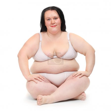 Happy overweight woman exercising