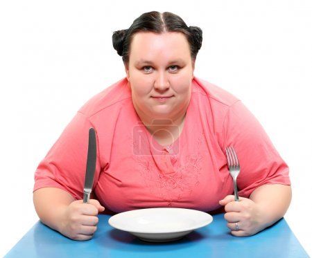 Hungry obese woman with empty plate. Funny picture on diet theme.