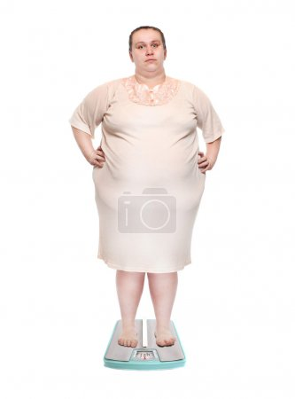 Overweight woman on a weighing machine.