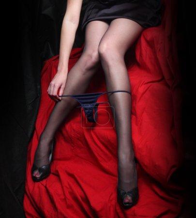Low key lighting studio shot young beautiful Gothic woman legs