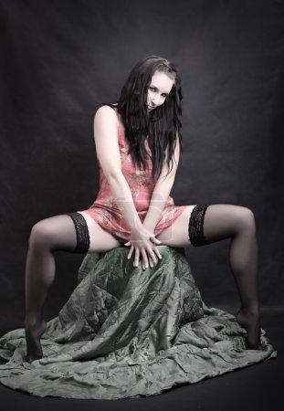 Low key lighting studio shot young beautiful Gothic Girl