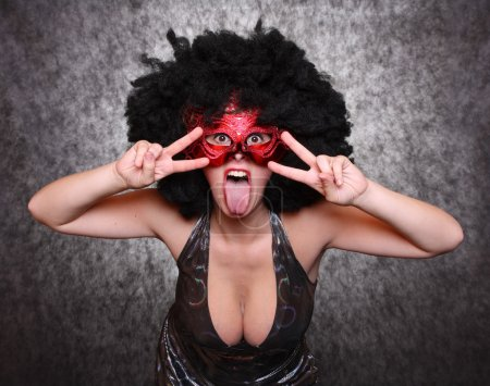 Expressive portrait showgirl with red mask