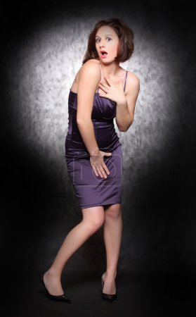 Woman in violet clothes posing