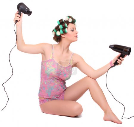 Nice girl with colorful hair-curlers
