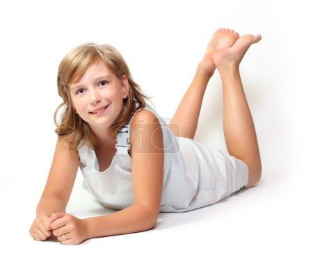 Portrait of little smiling girl posing in studio