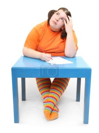 Zurück zum Schulkonzept. Frustrierter fettleibiger Student.
