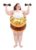 Overweight woman with body from sweet donuts. Nutrition concept.