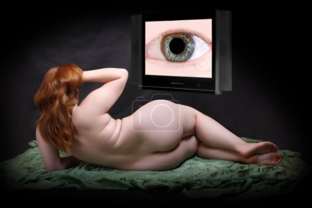 Overweight woman looking at television