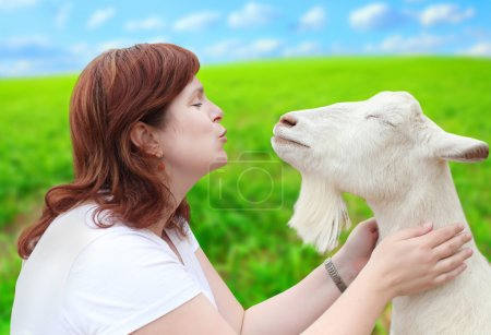 Woman with goat.
