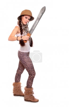 Young sexy woman dressed in panther leather with tropical helmet holding big cutlass
