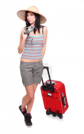 Woman going on vacation with camera and her suitcase.
