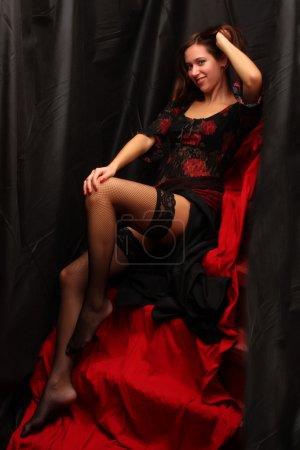 Low key lighting studio shot young attractive women in black sexy lingerie