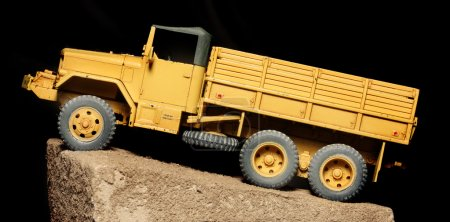 Photo for Vintage Yellow  model. Truck on Black Background - plastic kit 1:48 scale - close up - Royalty Free Image